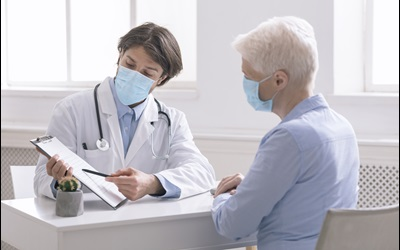 patient and doctor reviewing results together